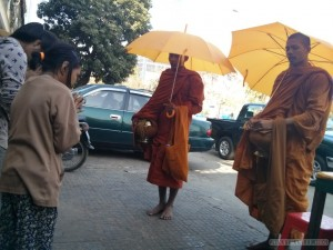 Phnom Penh - offering to monks