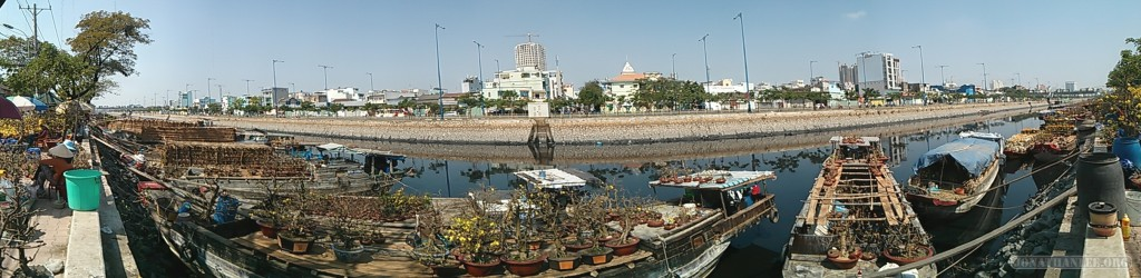 Saigon during Tet - panorama river flower market