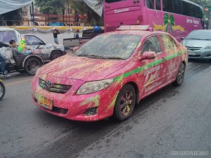 Songkran in Bangkok - paint covered taxi